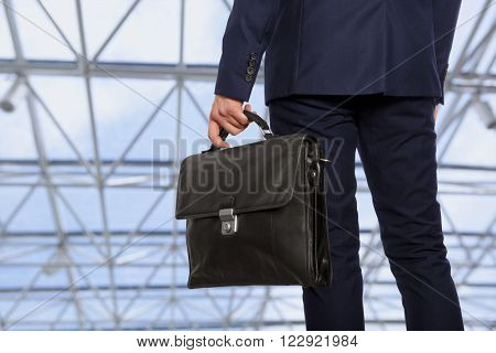 Portfolio investor. Businessman with briefcase