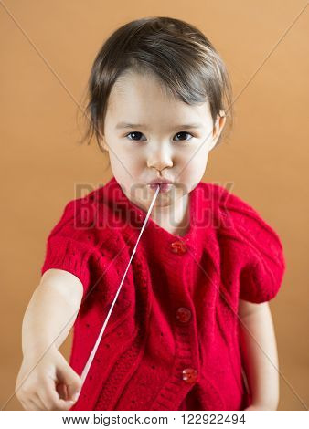 Young girl stretching a chewing gum from her mouth