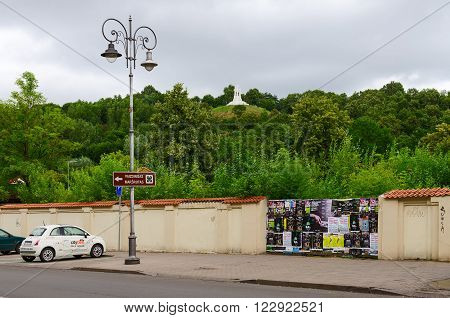 VILNIUS LITHUANIA - JULY 10 2015: Street of the Old town with views of Mount of Three Crosses Vilnius Lithuania