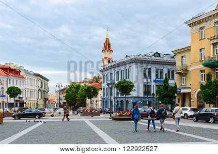 VILNIUS LITHUANIA - JULY 10 2015: Unidentified people go on the street Didzioji near building