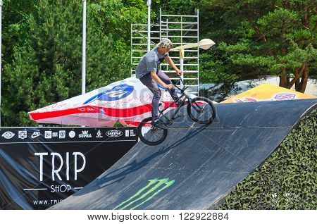 PALANGA LITHUANIA - JULY 12 2015: Unknown BMX rider is riding in the ramp Palanga Lithuania