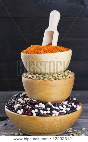 Various Haricot In Wooden Bowl On Dark Background