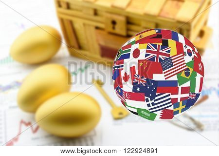 Flags globe over three golden eggs with a golden key and a wooden chest. Global long-term sustainable investment concept.