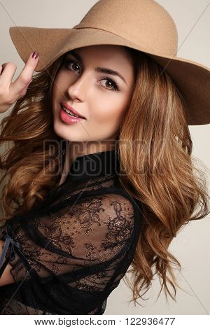 Woman With Dark Hair Wears Elegant Lace Blouse And Beige Hat