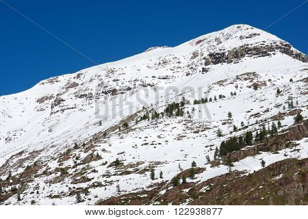 Snowy peak in Aspe Valley, France.