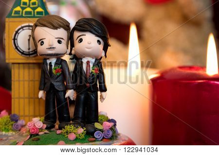 homosexuality same-sex marriage with two groom figurines and love concept
