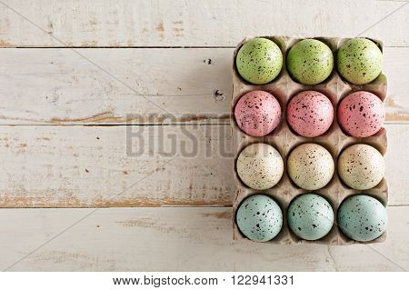 Easter background with pastel colorful speckled eggs