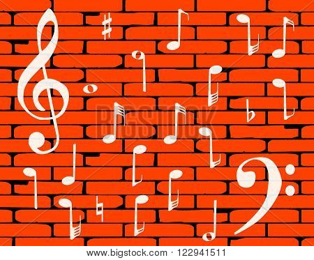 A well worn wall painted with musical notes and clef