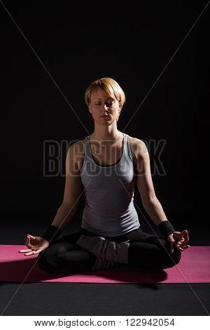 Young woman practicing yoga, Padmasana / Lotus Position