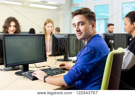 Shot of a young student using a computer during the IT class