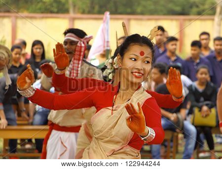 JORHAT, ASSAM/ INDIA - MARCH 21: A dancer performs traditional Bihu Dance . The Bihu dance is a folk dance from the Indian state of Assam related to the Bihu festival.