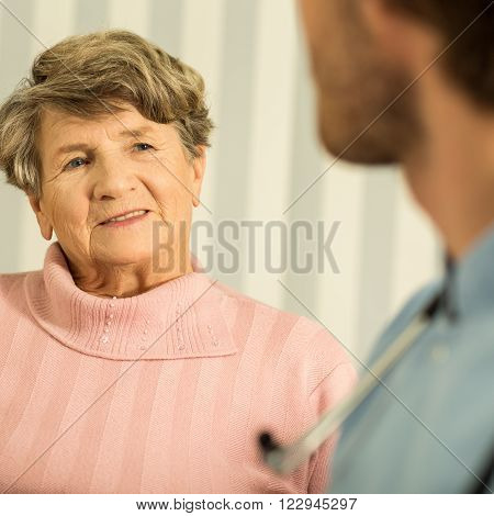 Male Nurse And Ill Senior