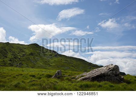view from a beautiful hiking route the kerry way in ireland of rocky and green landscape