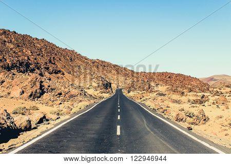 abandoned highway in desert landscape -empty, long, straight road - vintage look