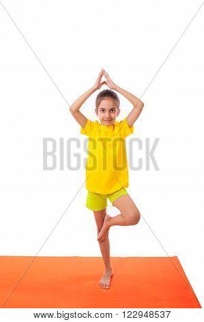 Kid girl child practicing yoga isolated on white background