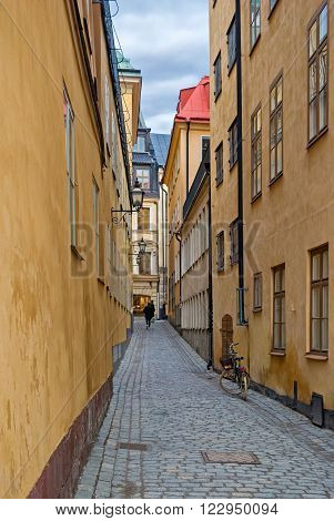 One of the many narrow streets paved with cobblestones in the old town of Stockholm - Gamla Stan. Sweden.