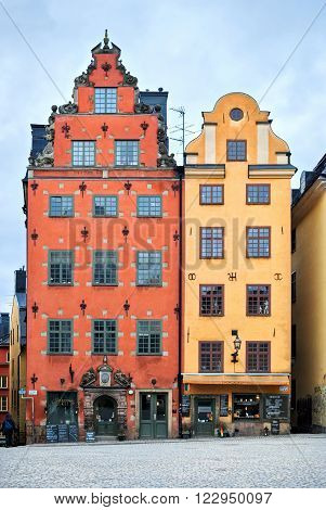 STOCKHOLM, SWEDEN, 07 march: The couple of houses in the square, paved with cobblestones in the old town of Stockholm - Gamla Stan, of 7 march, 2016.