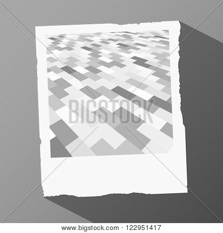 Old instant photo frame with gray brick pattern and long shadow on a striped surface.