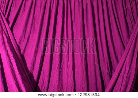 Draped Black Background Cloth Lit With Pink Gel