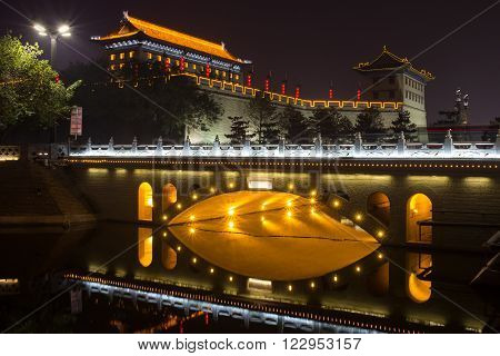 Illuminated famous ancient Bell Tower at night. China,  Xian