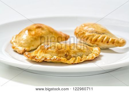 homemade fresh argentinian empanadas in white background