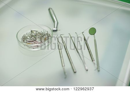 equipment and stomatology concept - close up of dental instruments
