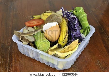 Kitchen food waste, vegetables, tea bags and fruit collected in re-used packaging, for home composting.