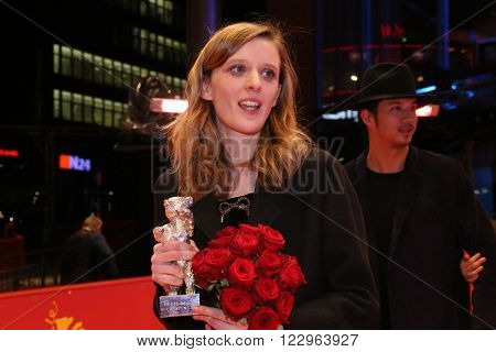 Mia Hansen-Love poses on the red carpet after the closing ceremony of the 66th Berlinale International Film Festival on February 20, 2016 in Berlin, Germany.