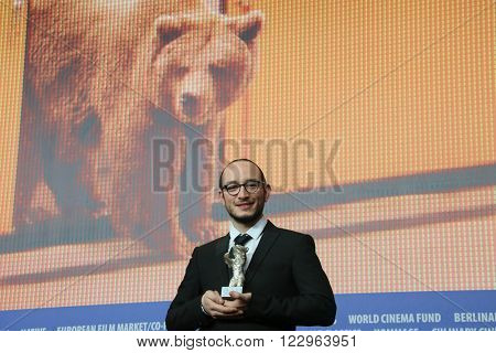 Tunisian actor Majd Mastoura  poses with his award at the award winners press conference of the 66th Berlinale International Film Festival on February 20, 2016 in Berlin, Germany.