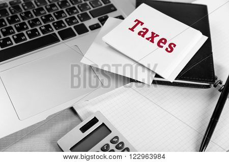 Taxes concept. Office supplies on the table