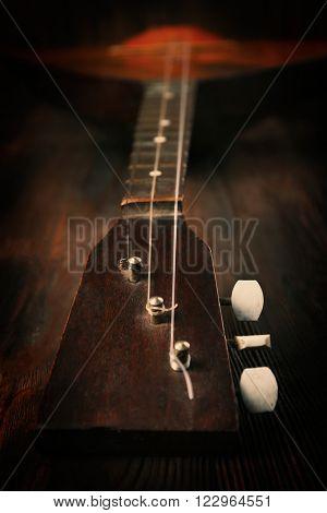 Folk musical instrument balalaika on wooden background, close up