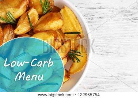 Baked potato and Low-Carb Menu text on wooden table