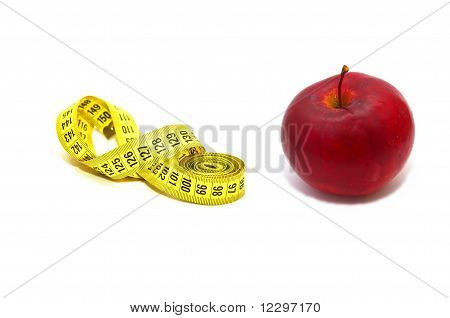 Measuring tape with red apple
