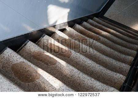 Rutted granite staircase worn out to the point of revealing the concrete underneath