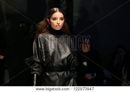 ISTANBUL TURKEY - MARCH 18 2016: A model showcases one of the latest creations of Derya Acikgoz in Mercedes-Benz Fashion Week Istanbul