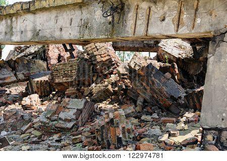 Auschwitz II - Birkenau crematorium II ruins with what remains of the chimney wing