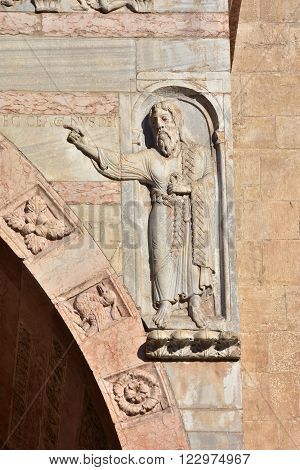 Detail from Verona Cathedral old romanesque porch with relief of John the Baptist and the inscription: