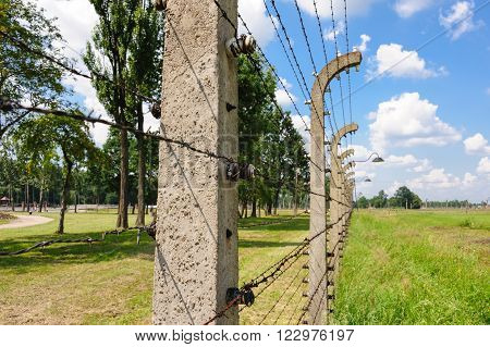Auschwitz II - Birkenau aspect and closeup of the electrified barbed wire fence