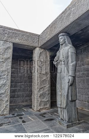 LOVCEN, MONTENEGRO - AUGUST 11, 2015: Female sculpture at the entrance of Njegos mausoleum, the work of sculptor Ivan Mestrovic.
