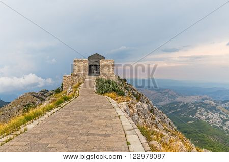 LOVCEN, MONTENEGRO - AUGUST 11, 2015: People sightseeing Njegos mausoleum in Lovcen mountain and national park in southwestern Montenegro. The mausoleum is a work of art by sculptor Ivan Mestrovic.