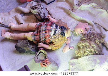 OSWIECIM, POLAND - JULY 3, 2009: Auschwitz I - Birkenau, children's doll and clothing collected from prisoners exhibited in Block 5 as Material Evidence of Crimes commited