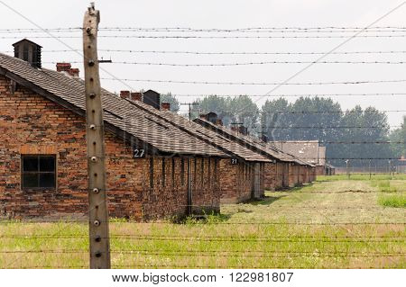 OSWIECIM, POLAND - JULY 3, 2009: Auschwitz II - Birkenau, barracks Blocks 27, 21, 15, 9 and 3 of Sector I