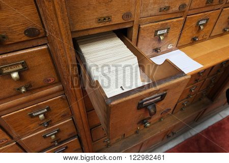 ATHENS GREECE - MARCH 10 2013: Greek National Library's alphabetical card catalog in old wooden drawer