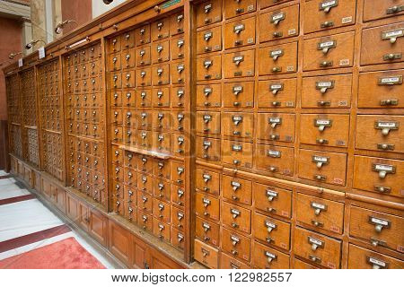 ATHENS GREECE - MARCH 10 2013: Greek National Library's alphabetical card catalog in old wooden drawers