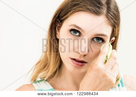 Sad woman with tissues on white background.