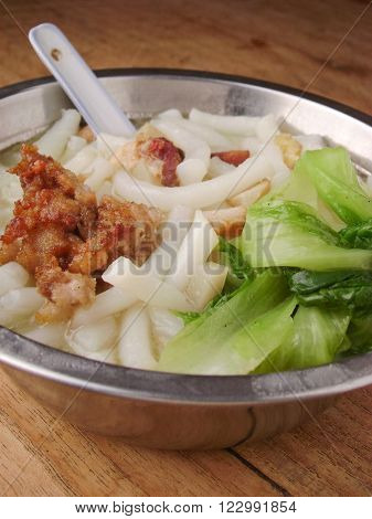 Lai fun noodles with lettuce and meat. Lai fun noodles are special Chinese noodles made from rice flour.