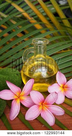 Pink plumeria and aromatic massage oil