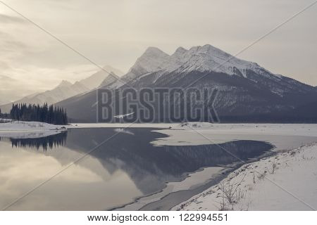 Rocky Mountain landscape in winter with reflections in Goat Pond.