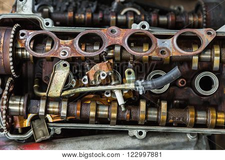 Close up of scrapheap of old car engine parts