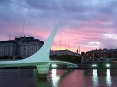 stock photo of calatrava  - the puente de las mujeres the bridge of women at puerto madero in buenos aires argentina at sunset - JPG